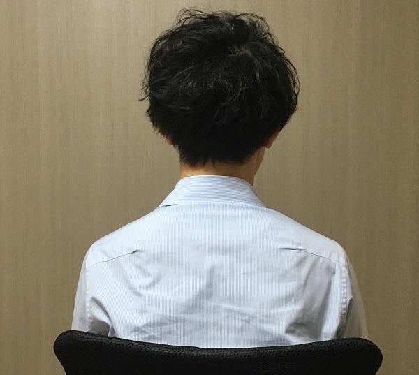 田中さんは、男性の服装で日常を送る。