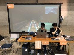 ▲ニコニコ超会議のマインクラフトブースに出展側として参加する山口(写真右)