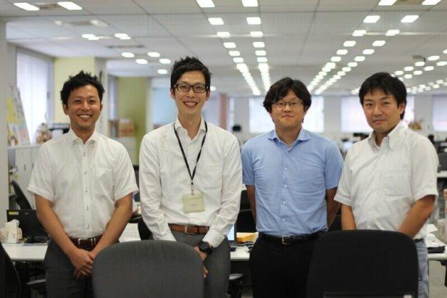 ▲チームメンバーと田中(写真 左から2番目)