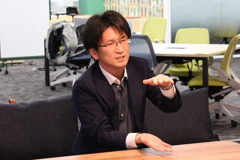 NEC 人事総務部の坂本俊一さん(編集部撮影。以下同じ)
